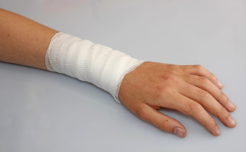 bandaged arm of child