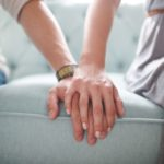 boy and girl touching hands