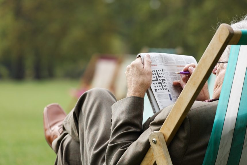 man doing a crossword