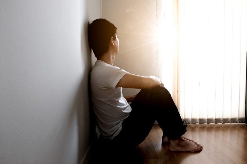 sad boy sitting in corner