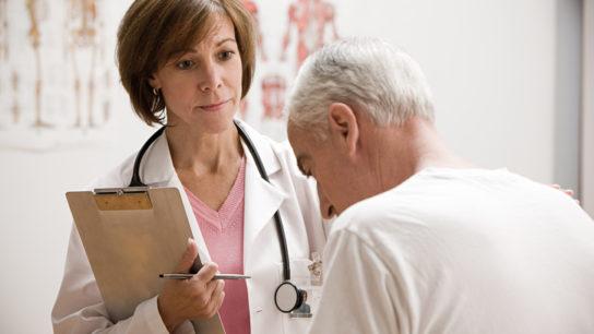 female doctor speaking to older patient