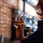 woman drinking at a bar
