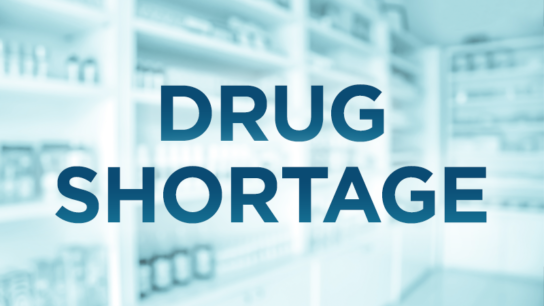 """Drug shortage"" text over background of pharmacy shelves"