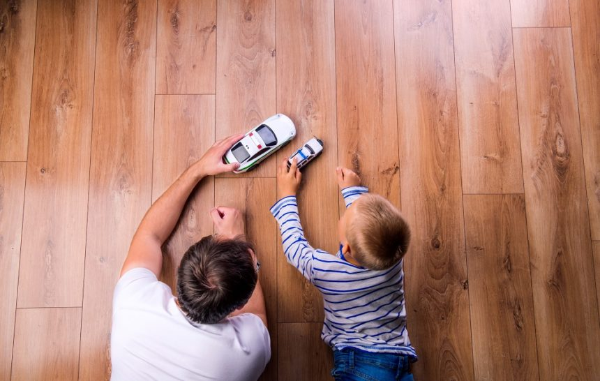 father and son playing with cars