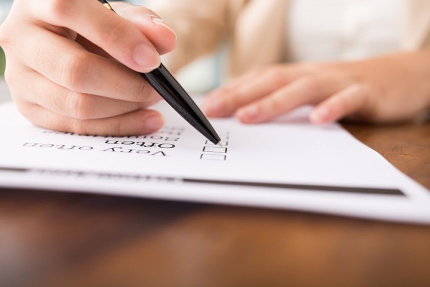 person filling out feelings checklist