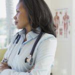 Female doctor looking away