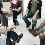 people sitting in a circle at group therapy