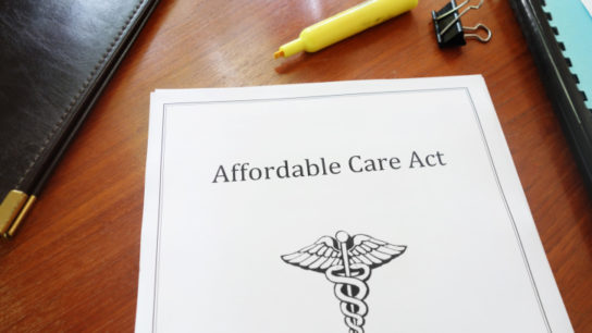 affordable care act pamphlet sitting on desktop