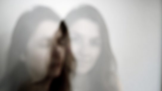 blurred image of woman.