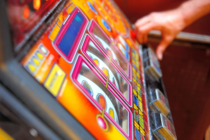 hand on slot machine gambling