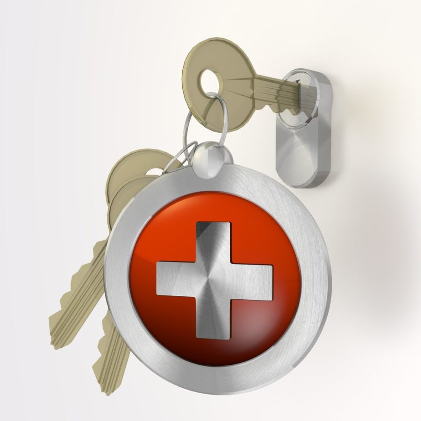 Key with medical logo keychain locking door