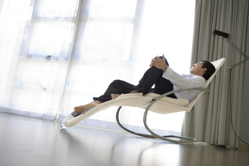 man reclining on chair
