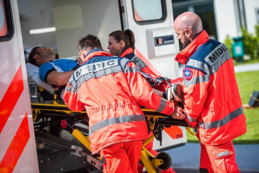 paramedics pushing stretcher