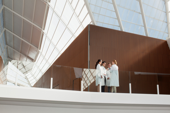 Group of physicians in a hospital balcony.