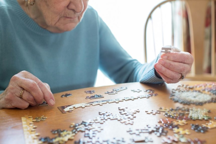 Older woman doing a puzzle