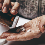 Pouring medication into hands.