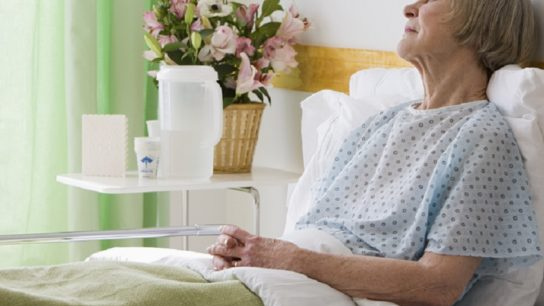 older woman laying in hospital bed