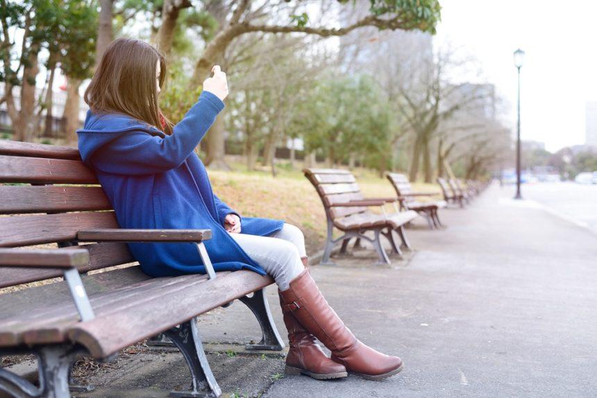 teenage girl sitting outside alone