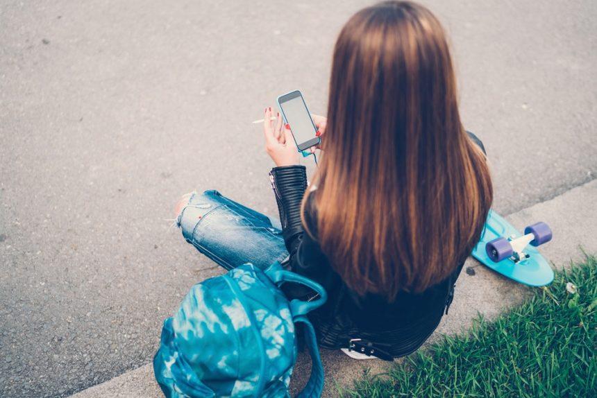 teen girl smoking and texting