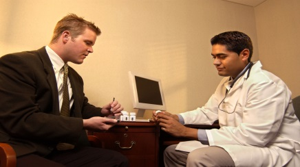 Male patient speaking to a physician.