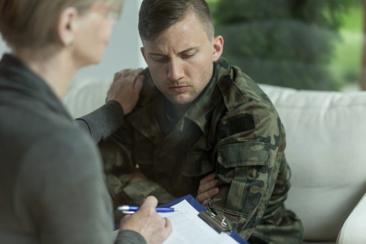 serious veteran talks with psychiatrist
