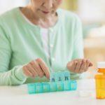 woman organizing pill box