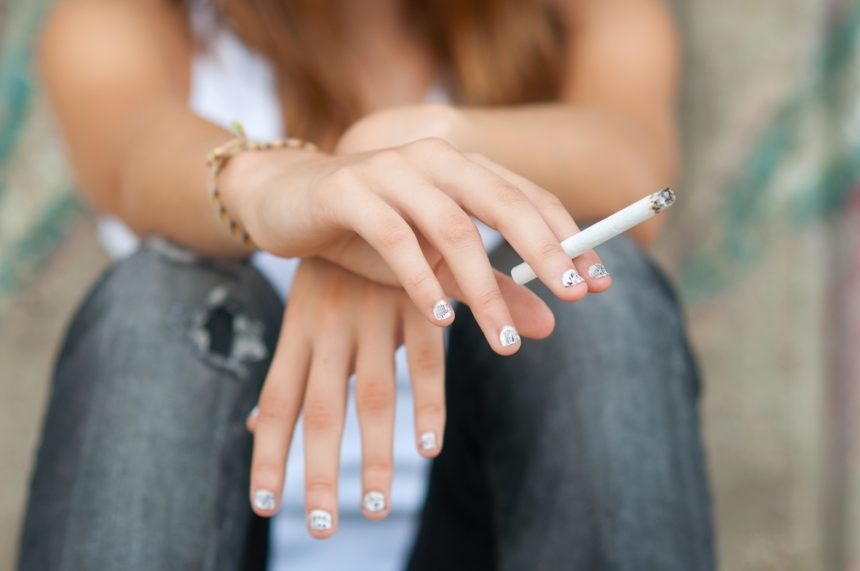 teen girl smoking a cigarette