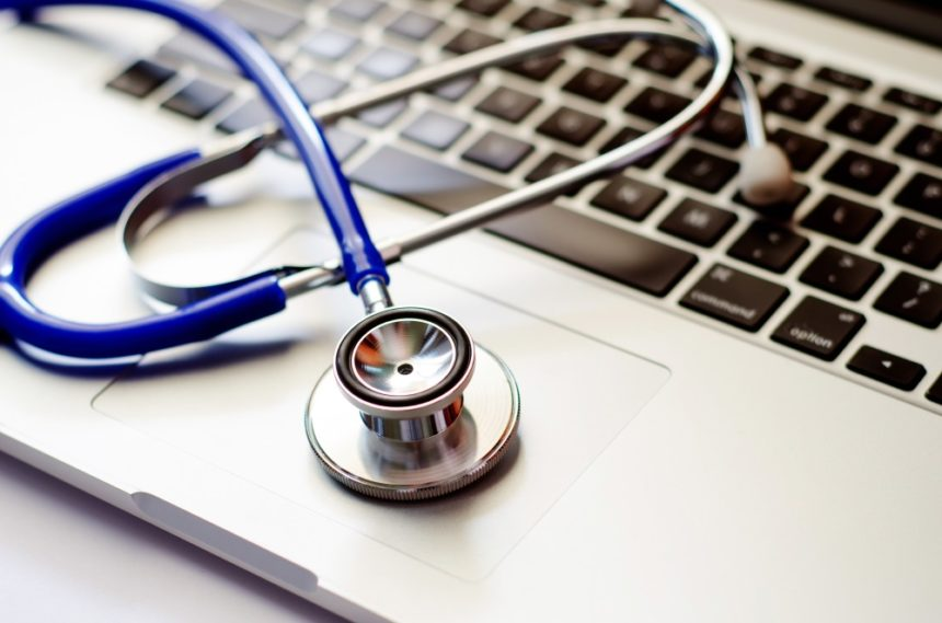 Stethoscope lying on a computer keyboard