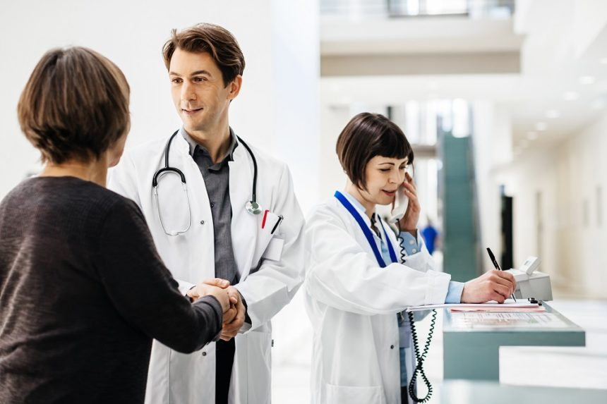 doctor shaking woman's hand