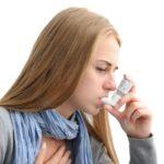 Female teen holding an inhaler