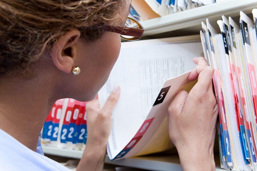 woman going through medical records