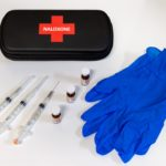 Naloxone vials, syringes, and gloves
