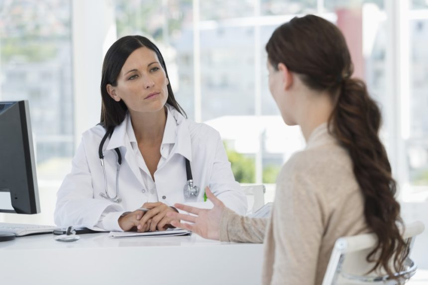 Physician speaking with a patient