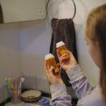 girl finding prescription pills