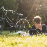 Adult woman reading in park