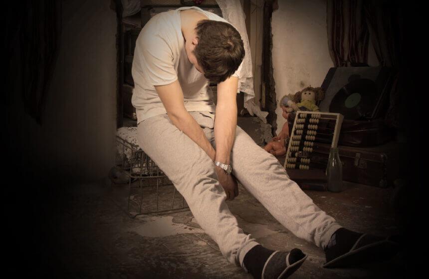 young man slumped
