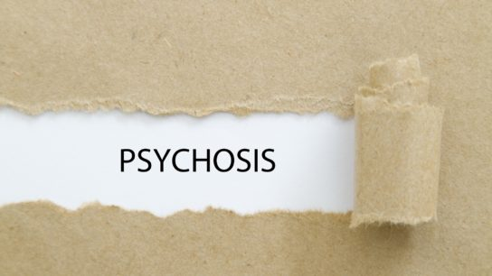 """The word """"psychosis"""" on paper."""