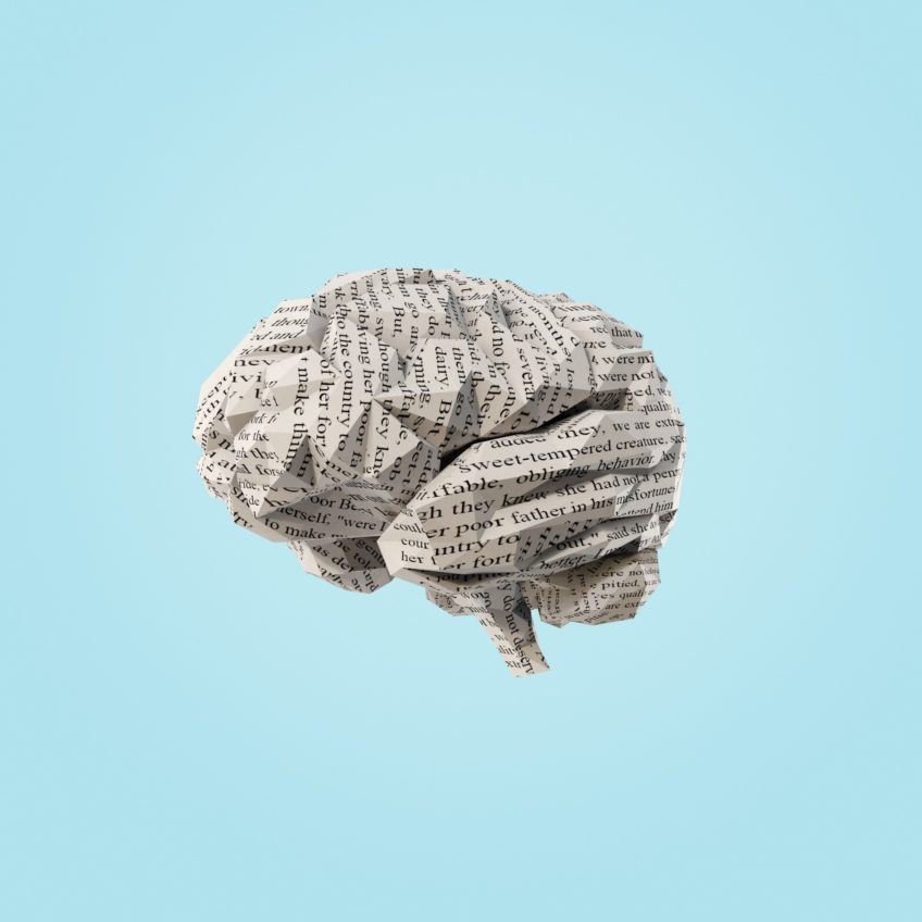 An image of a brain made out of newspaper.