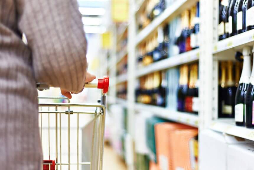 Person in liquor store with shopping cart