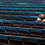 person sitting in auditorium