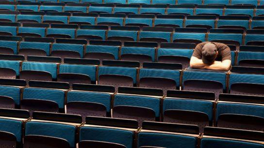 person sitting in auditorium