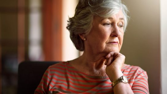 sad elderly woman, pondering